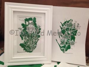 Originals of two floriography inkblots featuring Dandelion/Coquetry (left in frame) and Ivy/friendship (right)