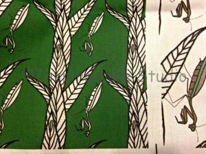 Close up of some of the Black and white line drawn praying mantis print on green background. Printed on basic cotton ultra.